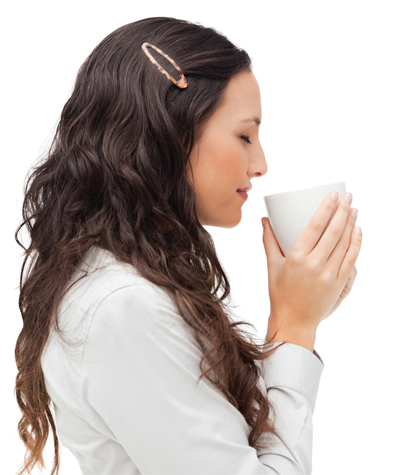 Woman warmed by hot cup of coffee